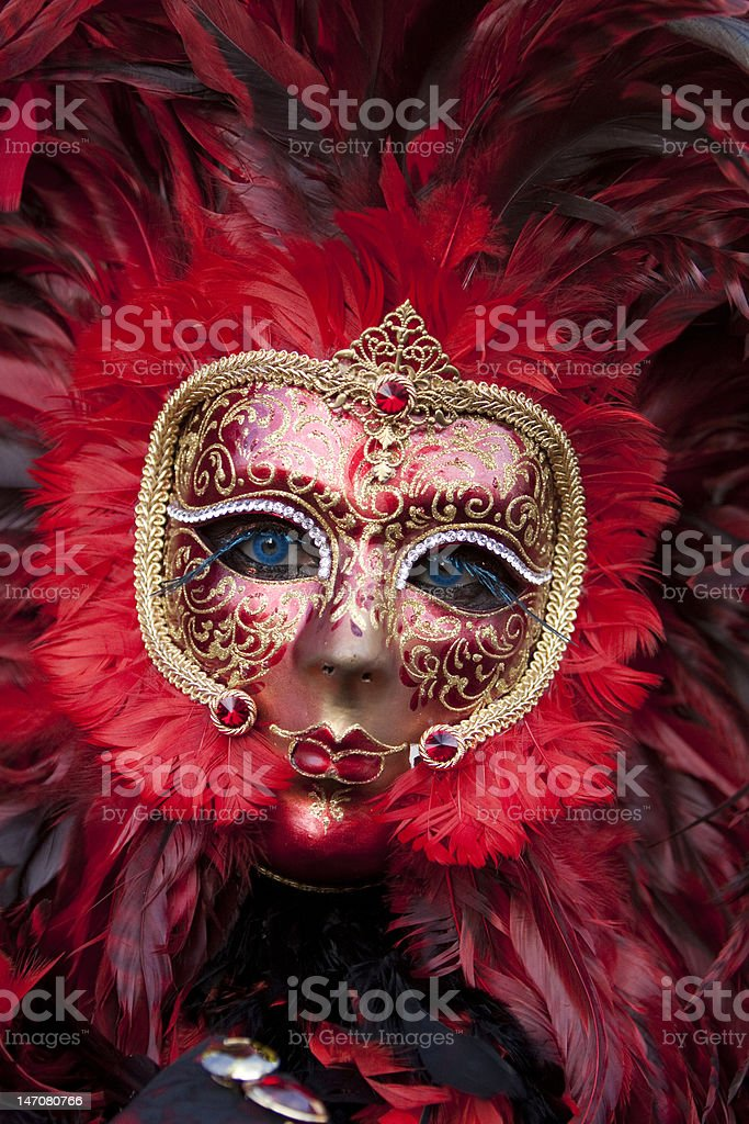 Venice Carnival Mask with purple Feathers stock photo