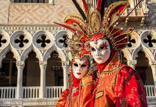 istock Venice Carnival Masks with Doge Palace 1098107672