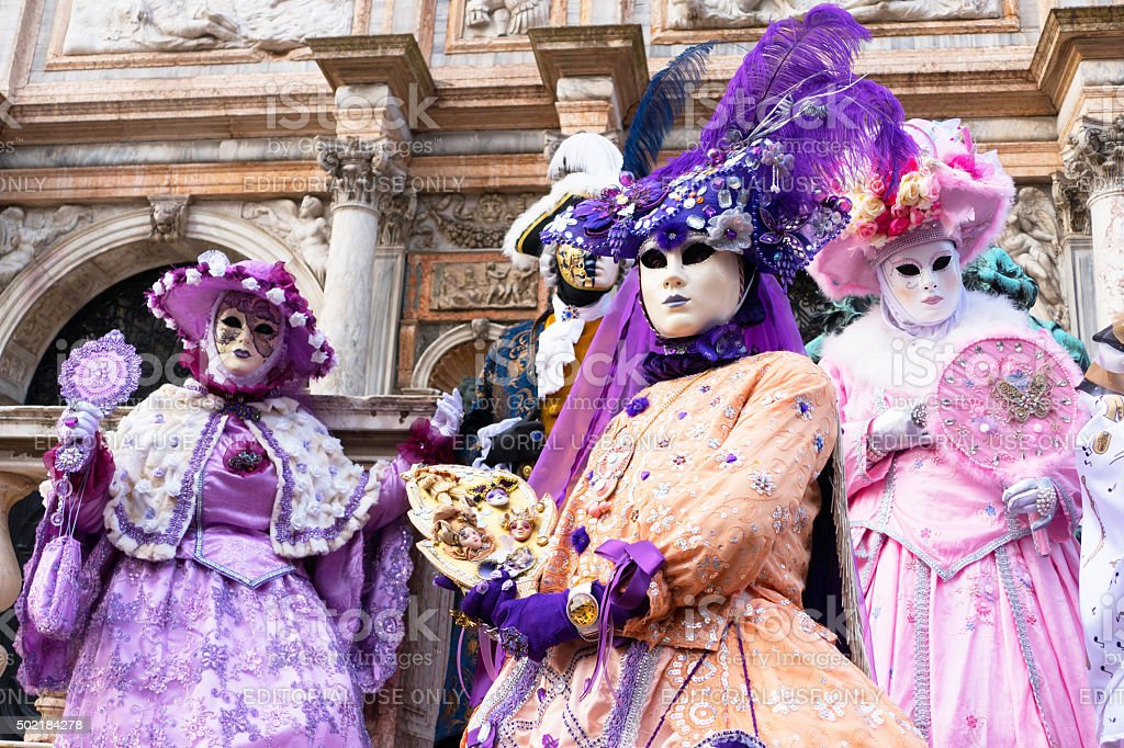 Venice Carnival models in pink and purple stock photo