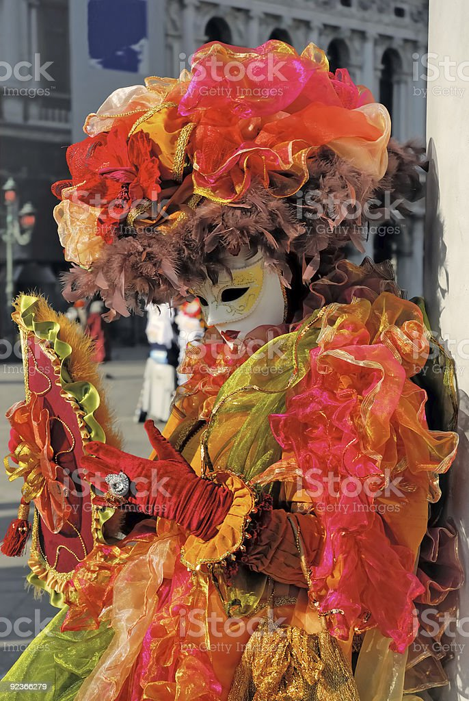 Venice carnival. Orange lady royalty-free stock photo