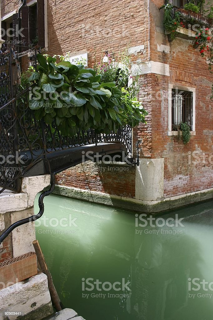 Venice channel with small bridge royalty-free stock photo