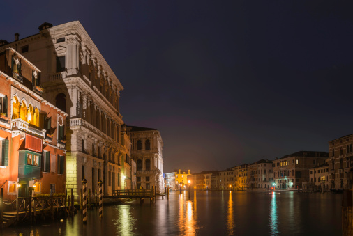 Venice colourful palazzo villas on Grand Canal at night Italy