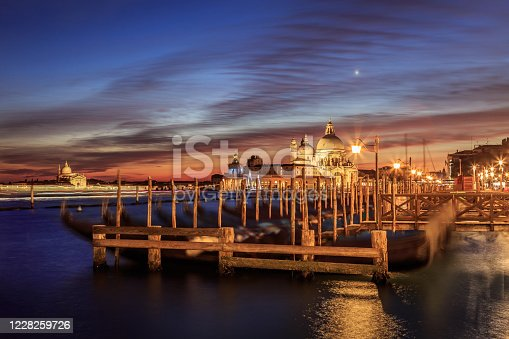 istock Venice cost with gondolas in twilight 1228259726