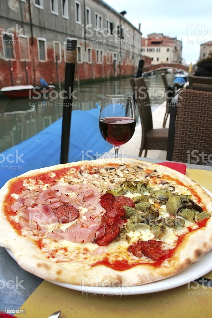 Venice: delicious pizza with a glass of wine royalty-free stock photo