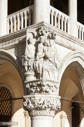 Venice, Doge palace white sculptures and capital in a sunny day in Italy