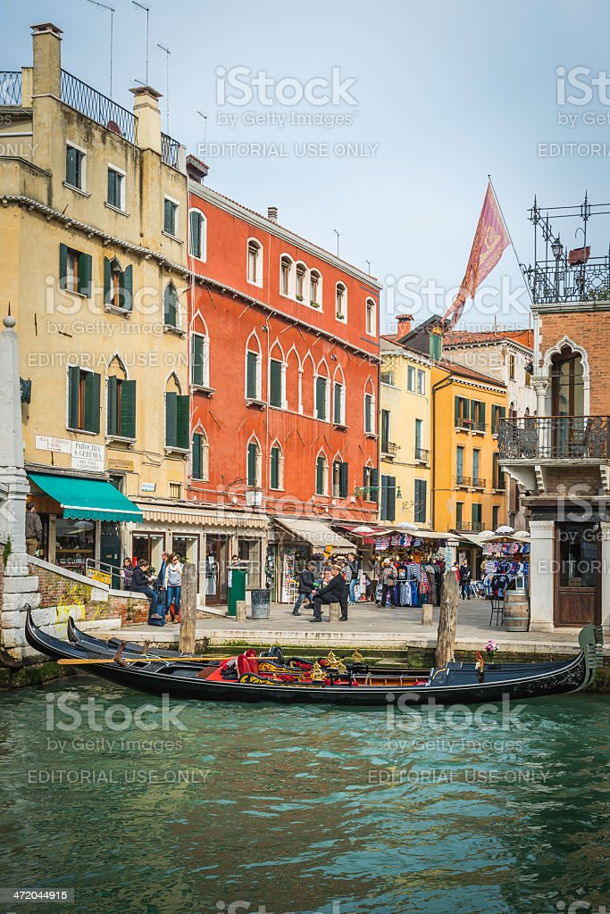 Venice gondoliers waiting for customers tourist crowds beside canal Italy stock photo
