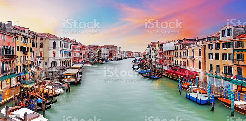 Venice Grand Canal gondolas, at sunset from Rialto Bridge stock photo