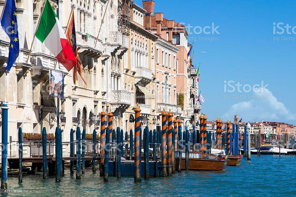 Venice Grand Canal mooring poles, taxi, European and Italian Flag stock photo