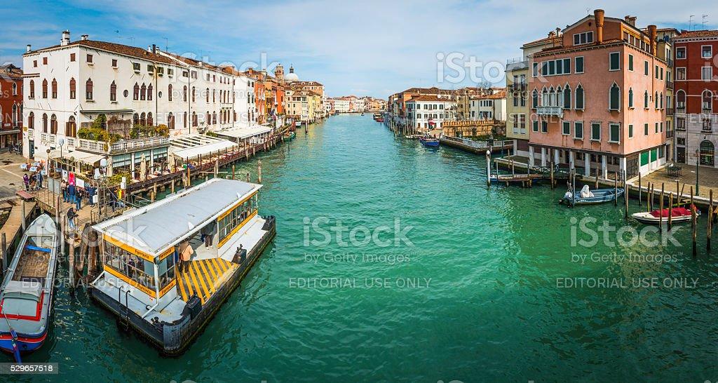 Venice Grand Canal people at restaurants waterbus dock Ferrovia Italy stock photo