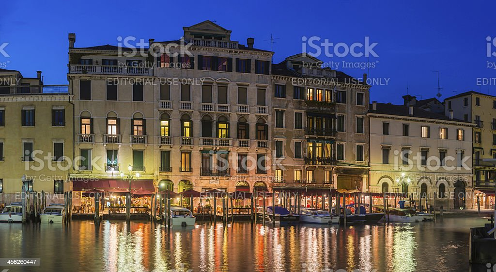 Venice Grand Canal Rialto restaurants hotels illuminated at dusk Italy royalty-free stock photo