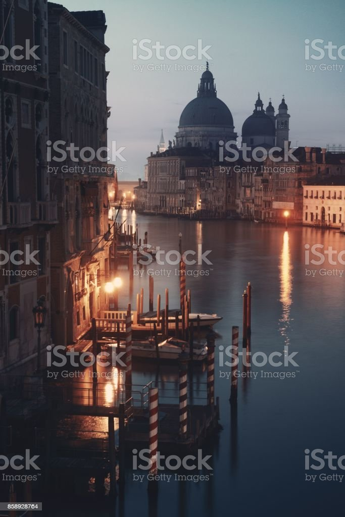 Venice Grand Canal sunrise and boat stock photo