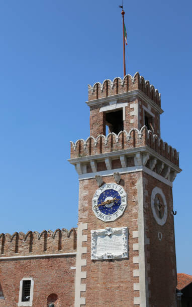 Venice Italy ancient palace called Arsenale Venice Italy clock tower of an ancient palace called Arsenale porta magna stock pictures, royalty-free photos & images