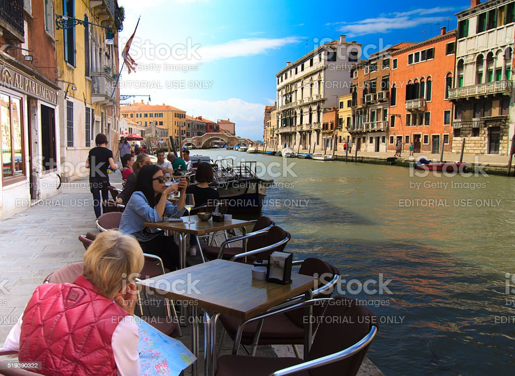 Venice, Italy: Diners/Tourists at Restaurant-Cafe, Canalside stock photo