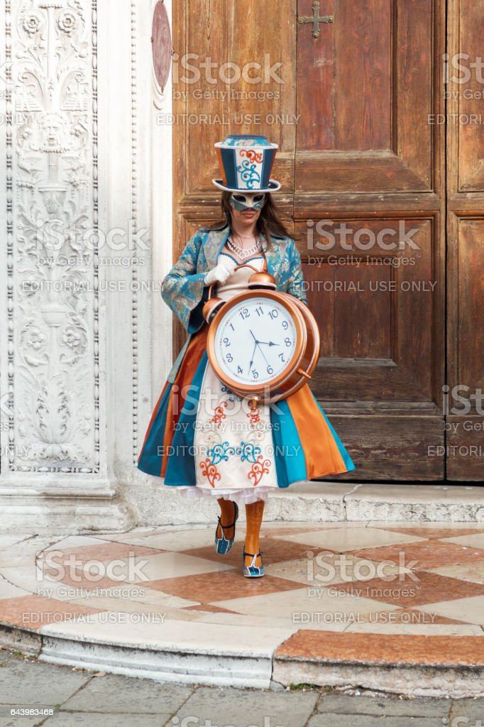 Venice, Italy - February 19 2017: Carnival mask and costume woman poses. stock photo