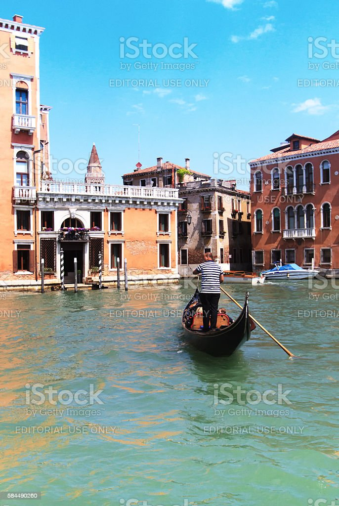 Venice, Italy: Gondolier On the Grand Canal stock photo