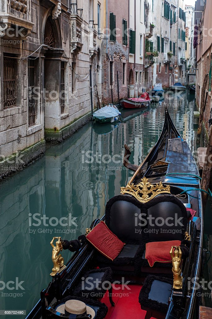 Venice  Italy, narrow channel with boat royalty-free stock photo