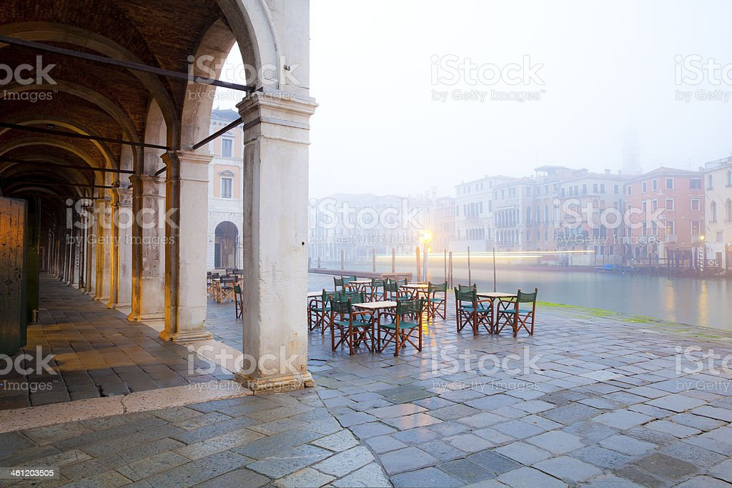 Venice, Italy Grand Canal with outdoor restaurant in winter fog. Ancient Stock Photo