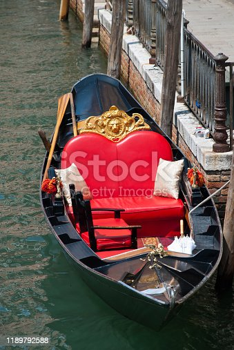 Venice, Italy: Traditional gondola in venetian water canal, close-up