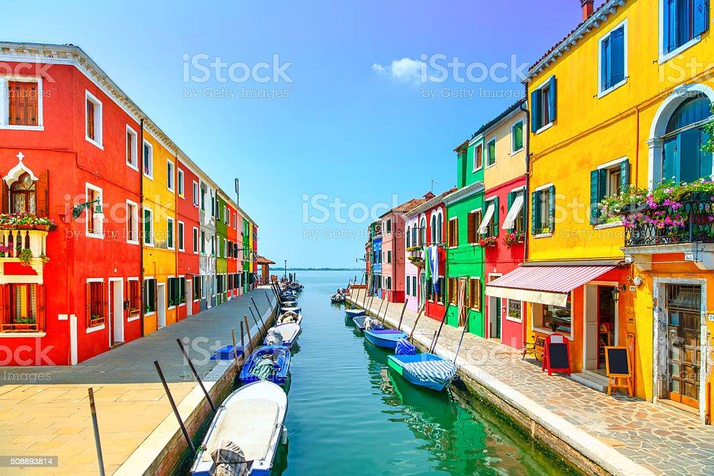 Venice landmark, Burano island canal, colorful houses and boats, Venice landmark, Burano island canal, colorful houses and boats, Italy. Long exposure photography Architecture Stock Photo
