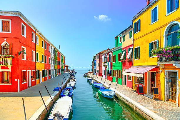 venice landmark, burano island canal, colorful houses and boats, - multi colored stock pictures, royalty-free photos & images