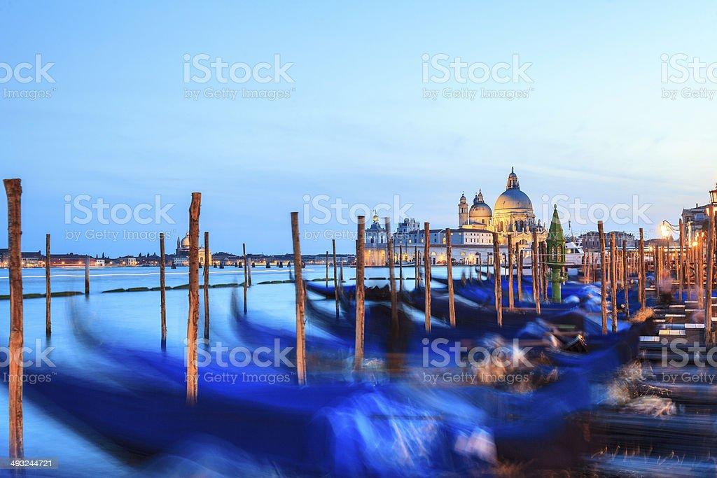 Venice night scene with gondolas and St. Maria Salute Basilica stock photo