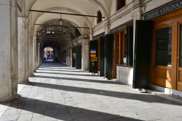 Venice old gallery with cafes and bars inside. stock photo