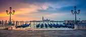 Panoramic cityscape image of Venice, Italy during sunrise.