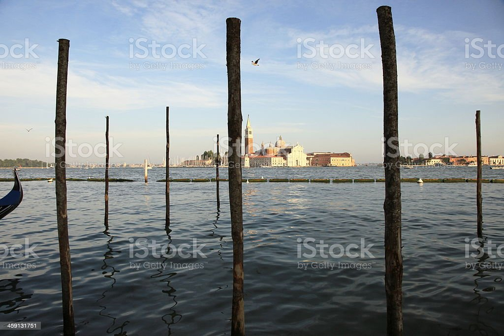 Venice pier peaceful sunset and dove, Italy royalty-free stock photo