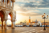 Venice postcard. World famous Venice landmarks. St. Mark's San Marco square with San Giorgio Maggiore church during amazing sunrise. Tourism and travel concept in Italy