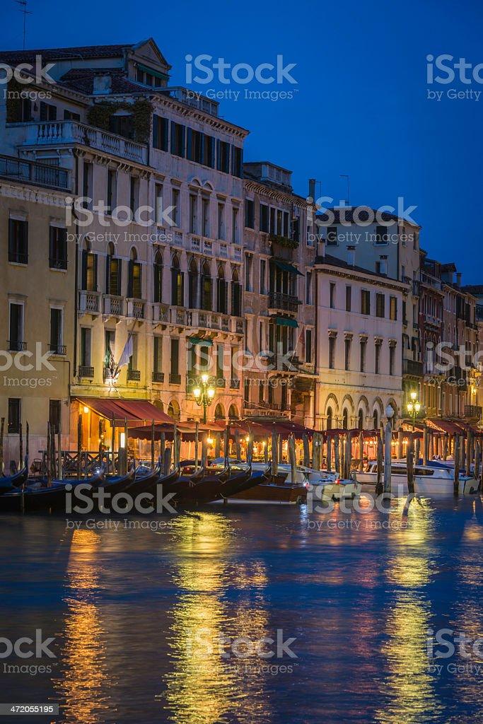 Warm light illuminating the waterside restaurants beside the Rialto...