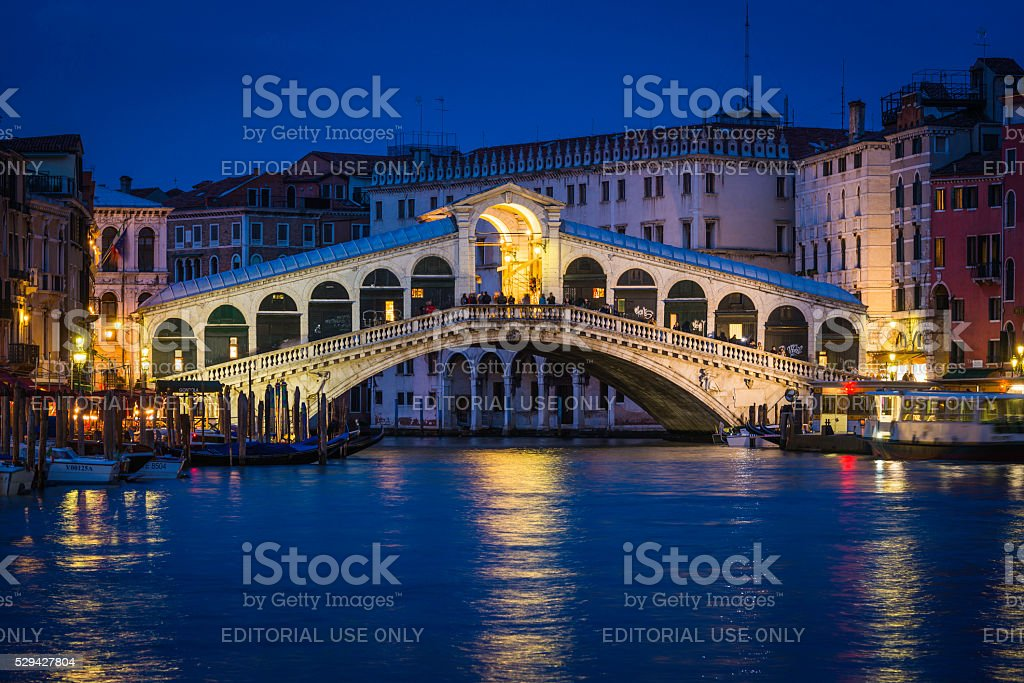 Venice Rialto Bridge and Grand Canal palazzo illuminated night Italy stock photo