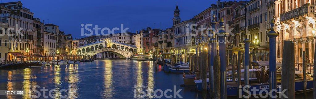 Venice Rialto Bridge Grand Canal gondolas illuminated landmark panorama Italy royalty-free stock photo