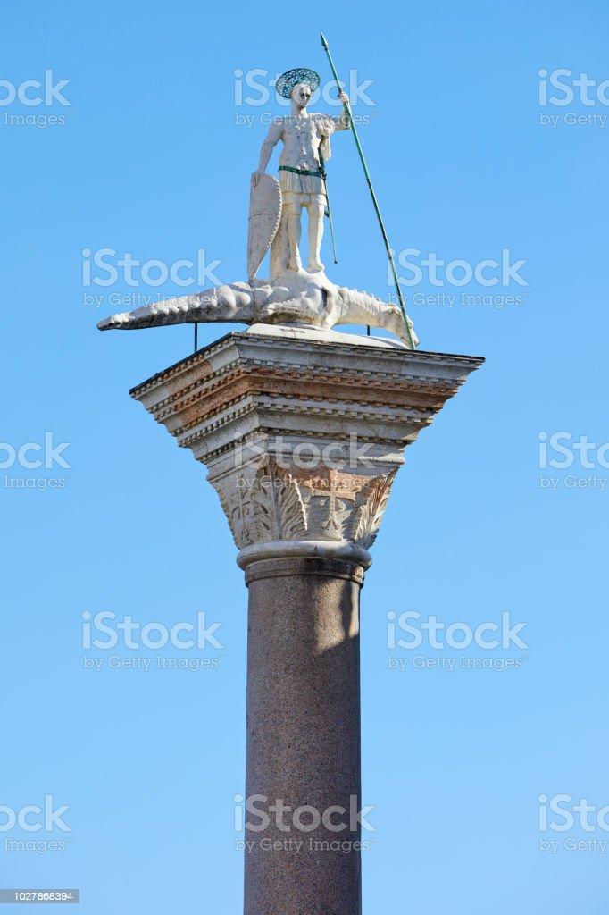 Venice, San Todaro statue on column in sunny day in Italy stock photo