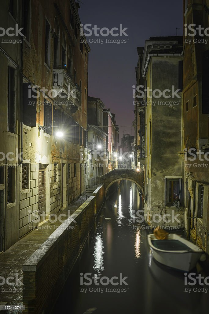 Venice stucco townhouses overlooking quiet canal at night Italy stock photo