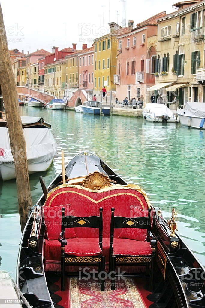 Venice: traditional gondola waiting for a romantic ride stock photo