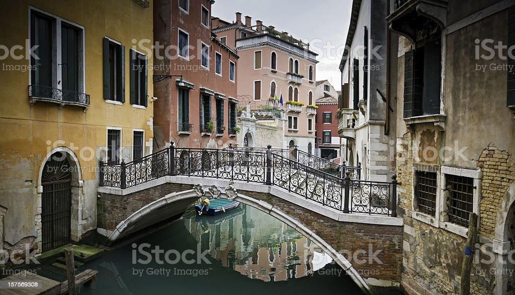 Venice tranquil canals colorful stucco villas pretty footbridge Veneto Italy royalty-free stock photo