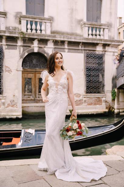 Venice wedding in italy a bride in a white dress with a train with a picture id1224837391?b=1&k=6&m=1224837391&s=612x612&w=0&h=92nk3ll lep4z9xjzzce0cqxbqppfqvw83c49rtzezs=
