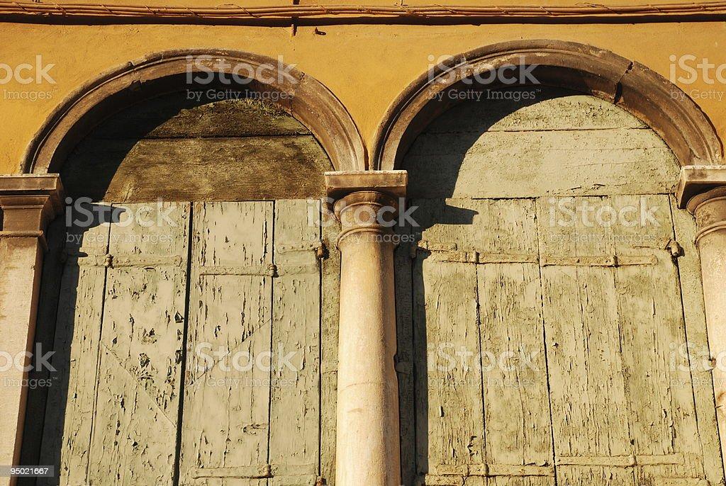 Venice Windows with Peeling Paint royalty-free stock photo