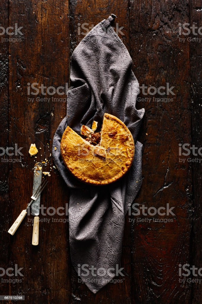 Venison pie on rustic background stock photo