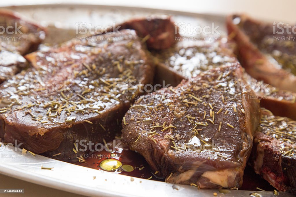 Venison steaks marinating locally hunted platter of venison steaks marinating in herbs and oil before cooking Animals Hunting Stock Photo