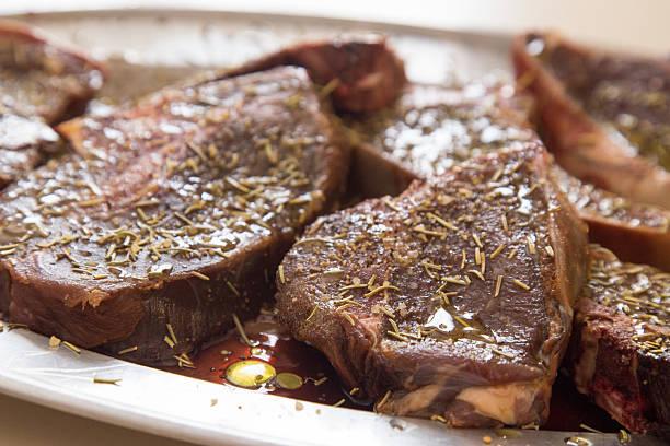 Venison steaks marinating stock photo