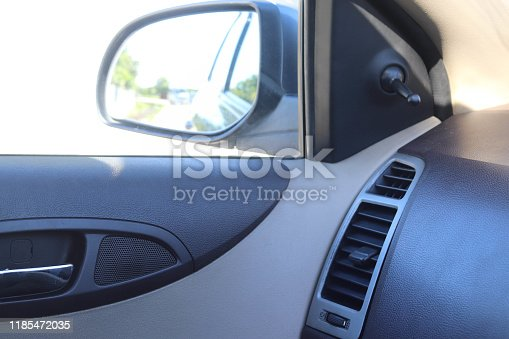 istock AC Vent on Interior of Car Dashboard and Mirror Adjustment Gear 1185472035