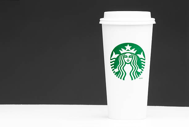 Venti starbucks take out cup on grey background with copyspace stock photo