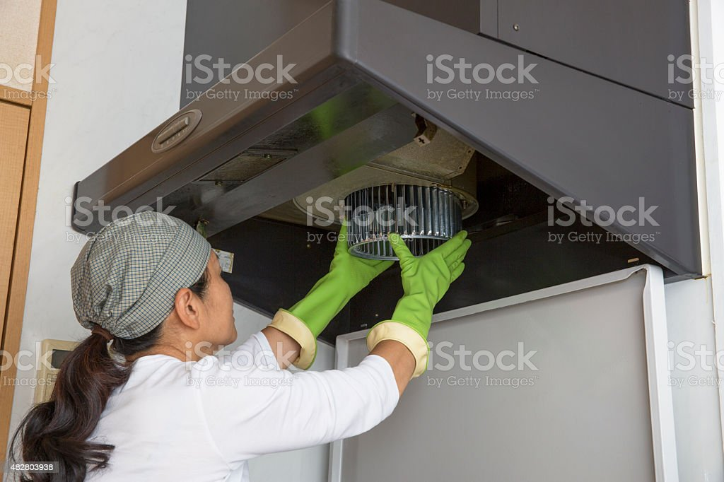 Ventilation fan cleaning stock photo