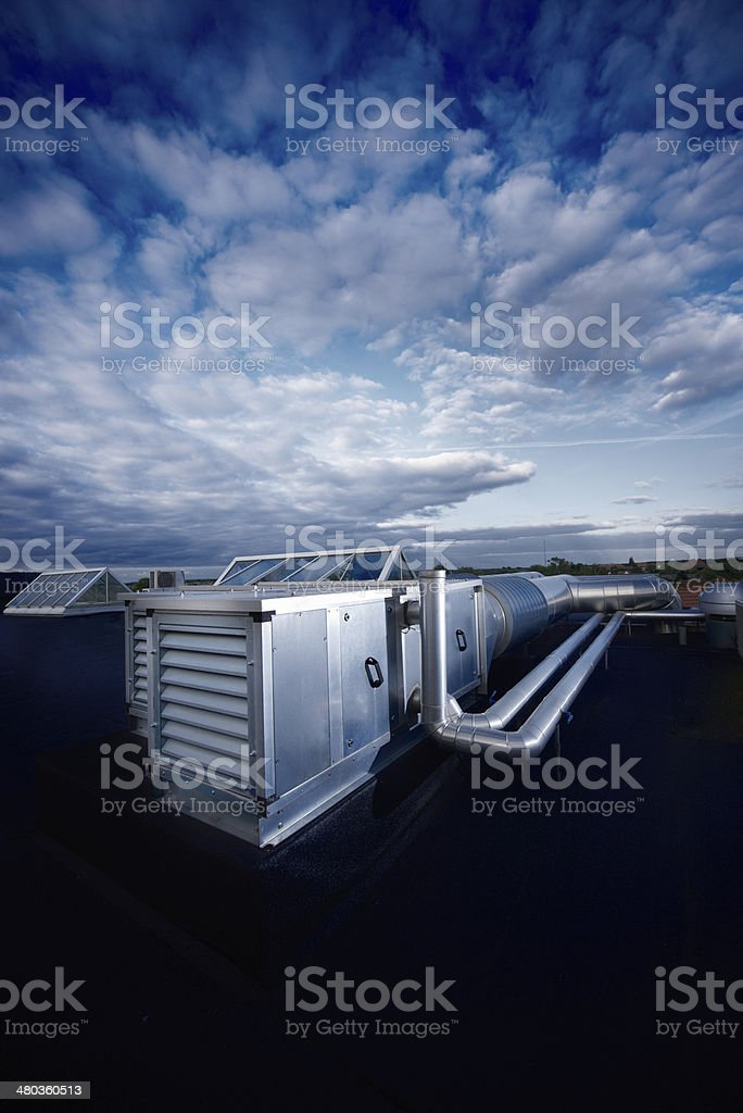 Ventilation system on a roof top stock photo