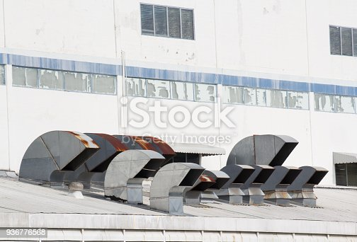 istock ventilation system on the old factory roof 936776568