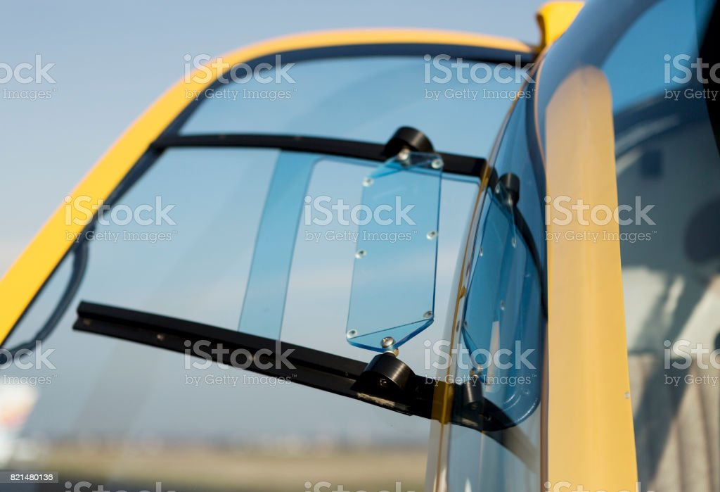 Ventilation window on the door of a yellow helicopter, selective focused. stock photo