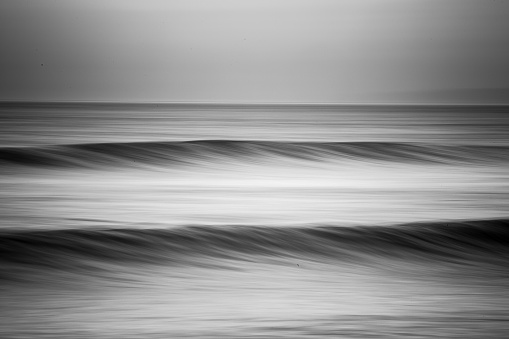 Different views and angles of ocean waves around Ventura, California, USA from the land and the water