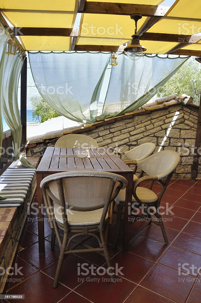 veranda with drapes and sea view royalty-free stock photo