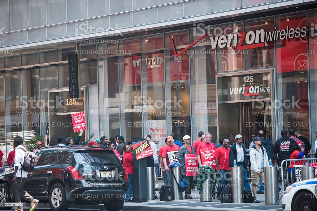 Verizon employees on strike picketing stock photo